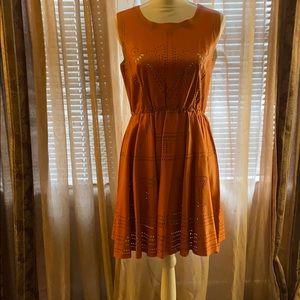 Orange leather dress